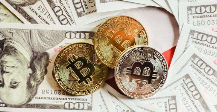 Image de Bitcoins et de dollars américains