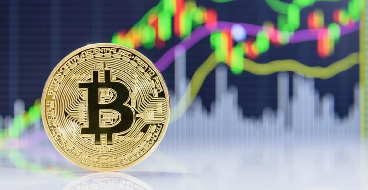 Représentation d'un bitcoin sur fond de graphique flou en forme de bâton de bougie